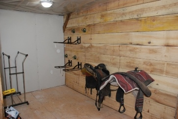 Tack room in progress - saddle racks side view